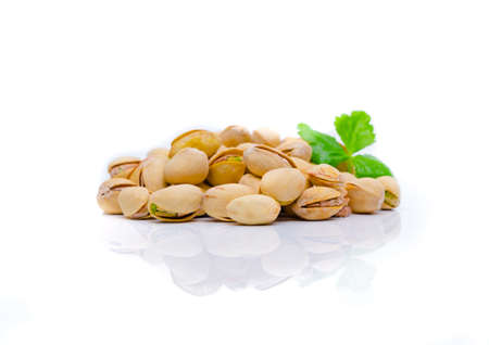 Pistachios on a white background . Pistachio nuts .