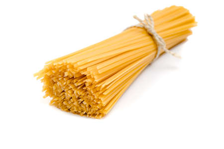 Yellow long spaghetti on white background. Food background concept.. 写真素材