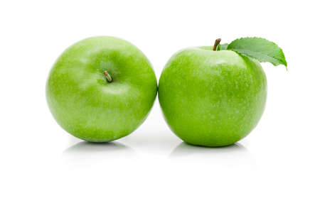 Ripe green apple with leaf on a white background. 写真素材