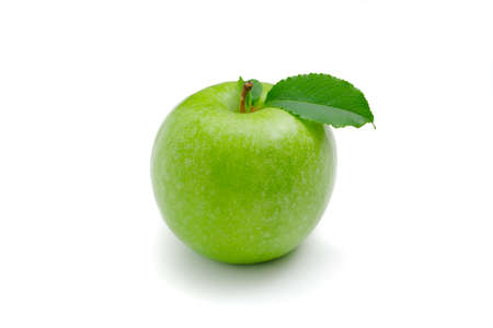 Ripe green apple with leaf on a white background .. 写真素材