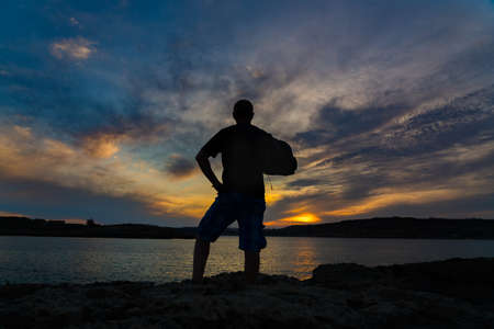 Sunset/Sunrise silhouette on the rock by the seaon Comino Island, Malta Gozo.. 写真素材