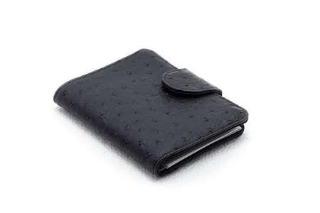 black leather purse on a white background closeup photo