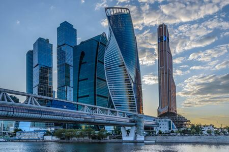 Modern and beautiful bridge over the river, leading to the towers of the Moscow City