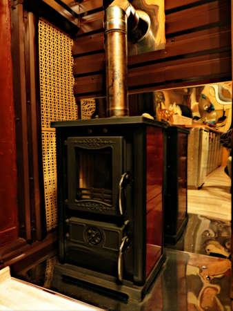 cast iron: Cast iron fireplace with mirrored power metal