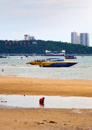 A child walks on a sandy beach. Pattaya. Thailand.