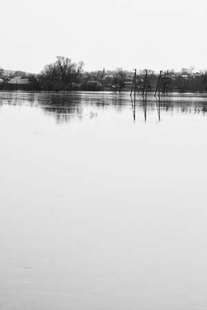 Spring high water in the middle zone of Russia. Black and white landscape.