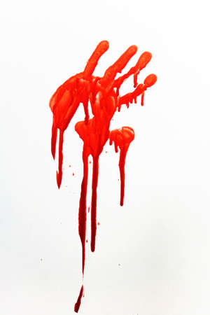 A human handprint stained with blood. Stock Photo