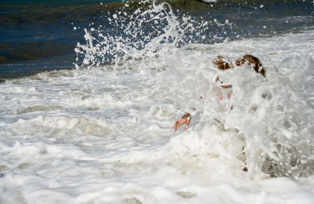 seamaid: Element. A large wave covered the girl in the sea.