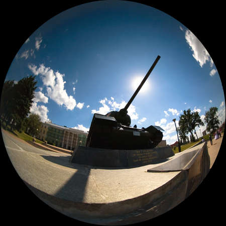 Nizhny Novgorod, Russia, July 20, 2013: Silhouette of a tank that covers the sun with its muzzle.