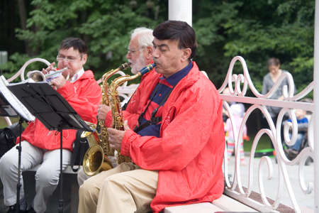 Moscow, Russia, July 28, 2013: Musicians playing trumpets in the park.