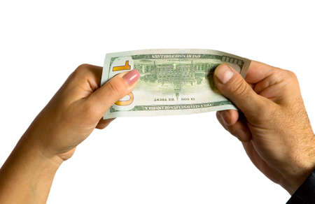 A mans hand and a womans hand hold a hundred-dollar bill. On a white background. Stock Photo