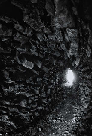A light in the end of a tunnel. Attention! The image contains the graininess of the photographic film!