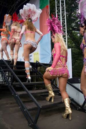 Moscow, Russia, July 28, 2013: Girls dancers in carnival costumes climb the stage.
