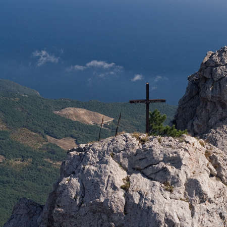 View from the Ai-Petri mountain to the Black Sea coast. The inscription on the cross
