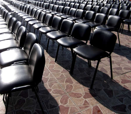 Empty chairs for the audience in straight rows.
