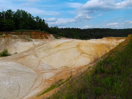 Landscape. Sandy quarry with traces of human presence.