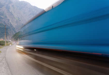 Cars quickly go on the road. Motion blur. Фото со стока