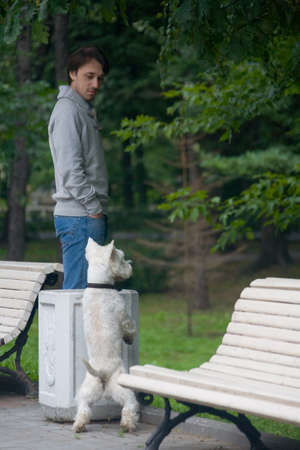 Moscow, Russia, July 28, 2013: A man communicates with a dog in the park. Editorial