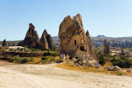 A mans dwelling is made in a rock. Cappadocia.