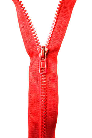 Red zipper with a runner on a white background. Close-up.