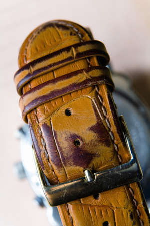 Old fastened worn strap for watches with clasp. Photographed close-up. 스톡 콘텐츠