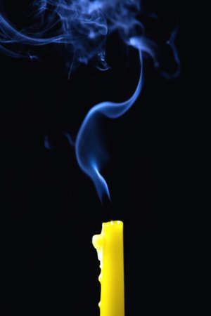 The smoke rises above the extinguished candle. Close-up. Banco de Imagens