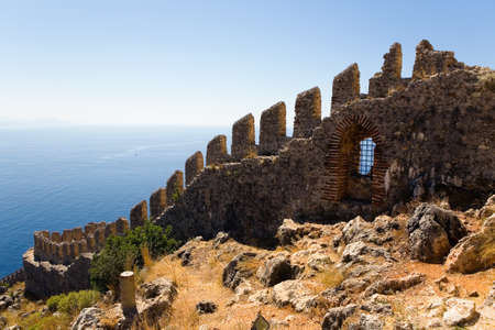 Fragment of the wall of the ancient fortress in Alanya against the background of the sea. Turkey. Editorial