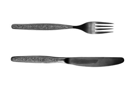 Metallic fork and knife of silvery color on a white background. Isolate.