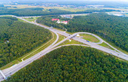 A view from above of the road, road junctions and cars. Aerial photography. 免版税图像
