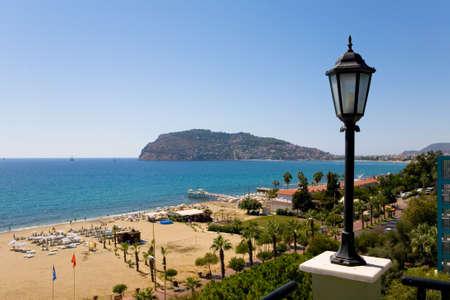 Lantern on the background of the beach of the coast of Alanya. Turkey. Stock Photo