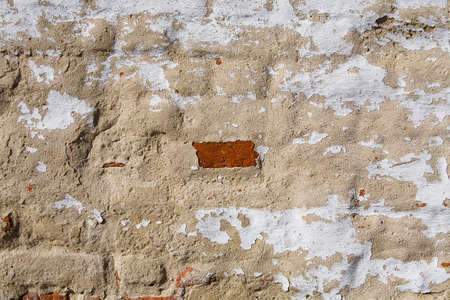Old shabby brick wall of the monastery close-up. Russia. Stock Photo