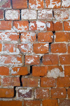 A crack in an old shabby brick wall of a monastery close up. Russia.