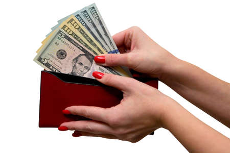 Elegant women's hands hold the purse and banknotes. Dollars. Isolate on white background. Banque d'images