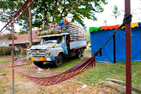 Hammock on the background of an old truck. Thailand.
