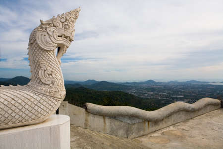 The head of the dragon in front of the entrance to the Temple of the Big Buddha in Phuket Island. Culture of Thailand.