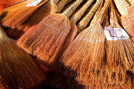 A lot of brooms for sale, on top of them lies the price tag. Georgia. 写真素材