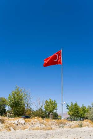 Near the road flying a huge Turkish flag. Goreme. 写真素材