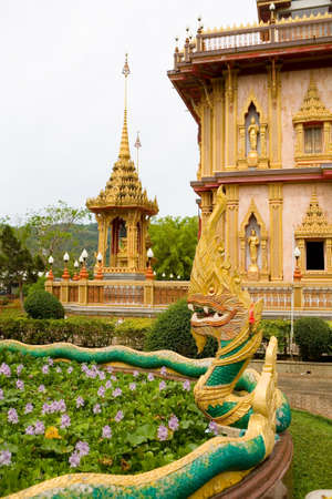 The sculpture of the dragon and the beautiful Chalong temple in the background. Phuket. 写真素材