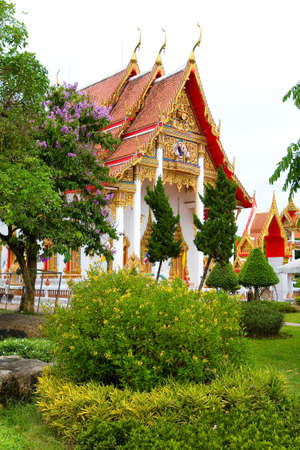 Beautiful flowering bushes on the background of the Buddhist temple Chalong. Thailand. 写真素材