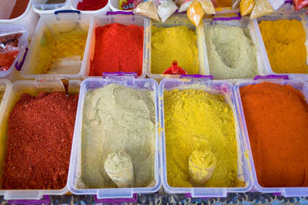 Multi-colored seasonings in containers on the counter. Georgia.