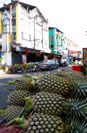 On the street are sold ripe fresh pineapples. Thailand.