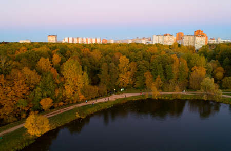 Autumn nature of central Russia from a height. Aerial view over Lebedyansky pond in the evening.