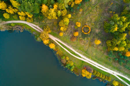 Autumn nature of central Russia from a height. Aerial photography over Lebedyansky pond in Moscow.