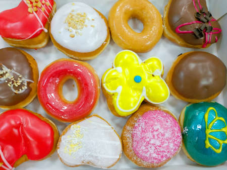 Delicious donuts covered with multi-colored glaze. Dessert.