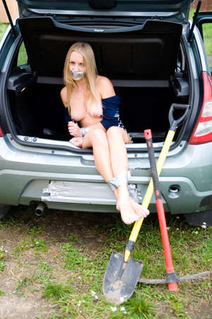Beautiful tied blonde in the trunk of a car. The crime.
