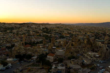 Evening top view of the small town of Goreme. Sunset in Turkish Cappadocia. 版權商用圖片