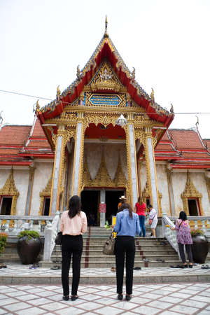 Phuket, Thailand, February 23, 2018: People stand in front of the entrance to the Chalong Buddhist temple. Redakční