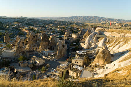 Evening top view of the small town of Goreme. Turkish Cappadocia. Reklamní fotografie