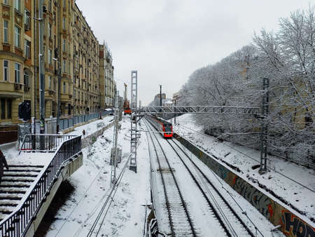 The railway tracks of the MCC along which the train is running. Winter landscape of Moscow.