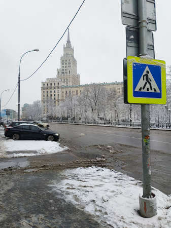 Pedestrian crossing road sign on a background of a high-rise building. Winter landscape of Moscow. Reklamní fotografie